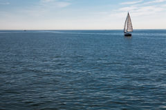 Lonely Sail boat on the Sea Stock Image