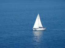 Lonely sail boat Royalty Free Stock Image