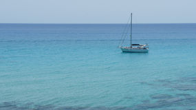 Lonely sailboat Royalty Free Stock Image