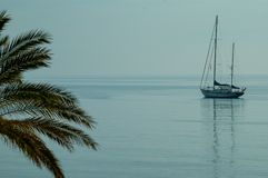 Lonely sailboat on the mediterranean sea, tranquility scenery on a sea royalty free stock images