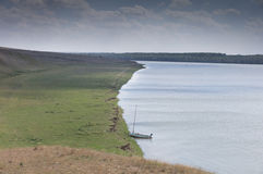 Lonely sailboat in the middle of nowhere Stock Photography