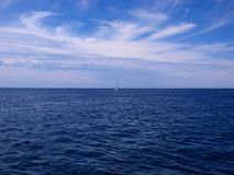 Lonely sailboat on the ocean Stock Image