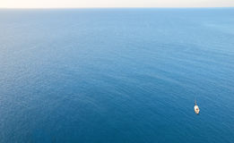 Lonely sailboat on the open sea Royalty Free Stock Photos