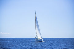 Lonely sailboat in the open sea. Romantic trip. Travel. Stock Images