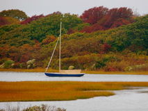 Lonely Sailboat on pond. Sailboat on Martha`s Vineyard during the fall of 2016 Stock Photography