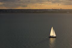 Sailing at sunset. Ireland Royalty Free Stock Image