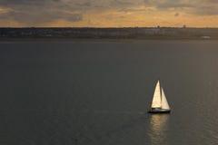 Sailing at sunset. Ireland Royalty Free Stock Image