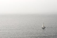 Lonely sailboat on water Royalty Free Stock Photo