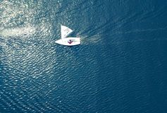 Lonely sailboats on the sea stock photo