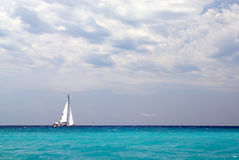 Lonely sailing boat Stock Photography