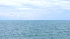 Lonely sailing boat. stock video