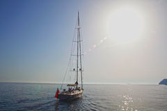 Lonely sailing boat. Boat sailing over Adriaitic sea Stock Photos