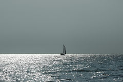 Lonely sailing boat. Royalty Free Stock Image