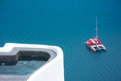 Lonely sailing boat in the vastness of aegean sea, Santorini. Lonely sailing boat in the vastness of aegean sea, Santorini, Greece Stock Images
