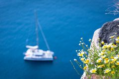 Lonely sailing boat in the vastness of aegean sea, Santorini. Lonely sailing boat in the vastness of aegean sea, Santorini, Greece Royalty Free Stock Photography