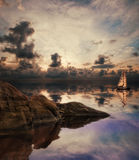 Lonely sailing vessel in lake. Stock Photo