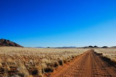 Lonely sand road in Namibia royalty free stock image