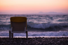 Lonely sea shore with sun bed in dusk Royalty Free Stock Photo