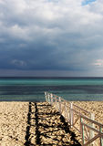 Lonely seascape with clouds and a fence Stock Photos