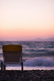 Lonely seashore with sun bed in sunset Royalty Free Stock Image