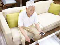 Lonely senior asian man Stock Photo
