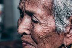 The old woman`s felling lonely. ,she`s senior woman in family and the elderly. Lonely senior woman smiling in camera portrait sad depressed,emotion, feelings stock images