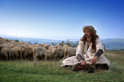 Lonely shepherd with sheep. Outside Royalty Free Stock Photos
