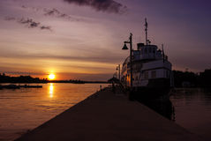 Lonely Ship Docked at the Wharf during Sunset Royalty Free Stock Images