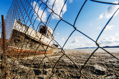 The lonely ship frozen in ices of Lake Baikal Royalty Free Stock Image