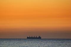 Lonely ship on a horizon Stock Photos