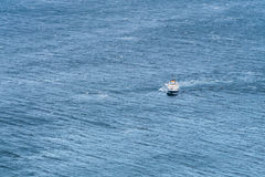 Lonely ship in the ocean. Royalty Free Stock Photos