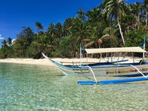 A lonely ship on the paradise sandy beach,with palm trees, Phili royalty free stock image