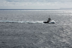 Lonely ship in the vast ocean Stock Photography
