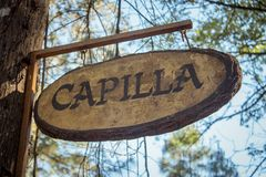Lonely sign that reads `Capilla` in the forest royalty free stock photo
