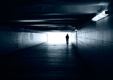 Lonely silhouette in a subway tunnel Royalty Free Stock Image