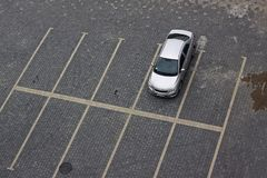 Lonely silver car. In an empty car park. Horizontal photo Royalty Free Stock Photography