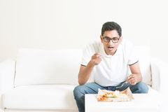 Lonely single man eating food alone Royalty Free Stock Photos