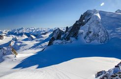 Lonely ski slope in the top of french Alps. Perfect winter holiday in Chamonix Mont Blanc. stock photos