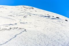 Lonely skier. The lonely skier clambers on the mountain royalty free stock photos
