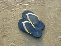 Lonely Slippers. A pair of slippers on the beach stock images