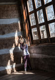 Lonely small baby girl in empty cabin Royalty Free Stock Photos