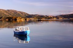 Lonely small fishing boat in the Norwegian fjords Stock Image