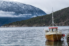 Lonely small fishing boat Stock Photo