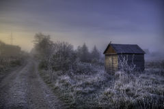 Lonely small hut. The photo shows autumn frosty sunrise and a lone hut Royalty Free Stock Photos