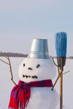 Lonely snowman at a snowy field Royalty Free Stock Photography