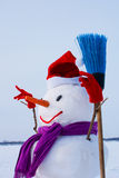 Lonely snowman at a snowy field Royalty Free Stock Image