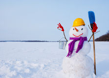 Lonely snowman at a snowy field Stock Photos