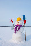 Lonely snowman at a snowy field Stock Images