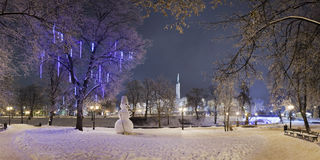Lonely snowman in winter night Royalty Free Stock Photography