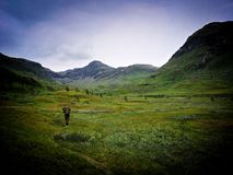 Lonely solder walk. A solder walking the distance in the hills and mountains in narvik stock photo